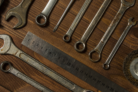 grinding teeth: Set of hand tools on a wooden table Stock Photo