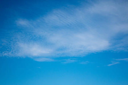 Layered clouds against the background of a bright blue sky Stock Photo