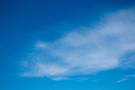 open windows: Layered clouds against the background of a bright blue sky Stock Photo