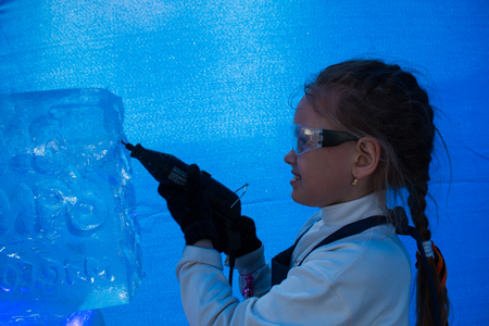 stylus: Girl of seven years in the master class on ice sculpture Stock Photo