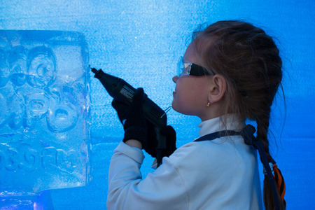 cutter: Girl of seven years in the master class on ice sculpture Stock Photo
