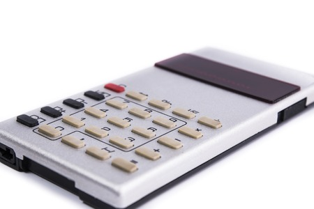 subtraction: Old silver calculator made by USSR with red display on white background
