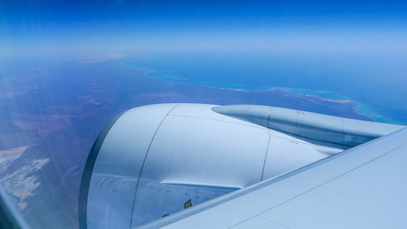 view from the window of a passenger aircraft with the passenger space at high altitudes