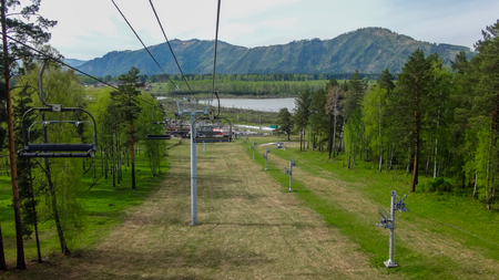 ropeway: Ropeway in the gorge of the mountain altai in the summer Stock Photo