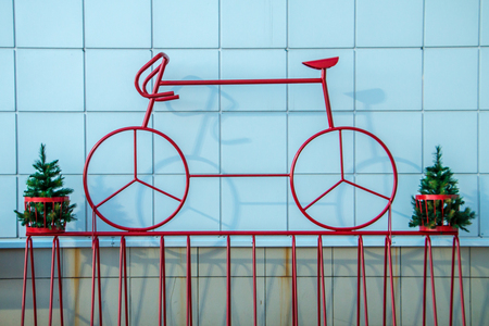 decorative red sport bike near the wall of the supermarket, street art