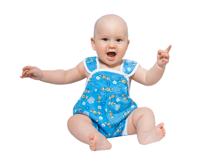 Portrait of a happy baby in a blue Romper and beret on a white background