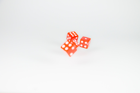 square dice in red on a white background