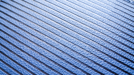 blue perforated skin texture, diagonally framed, with sun glare Imagens