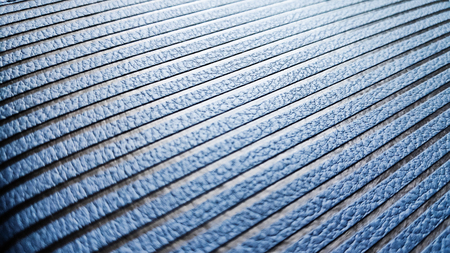 blue perforated skin texture, diagonally framed, with sun glare Stock Photo