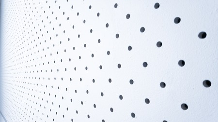 perforated wall texture of modern white design, many holes