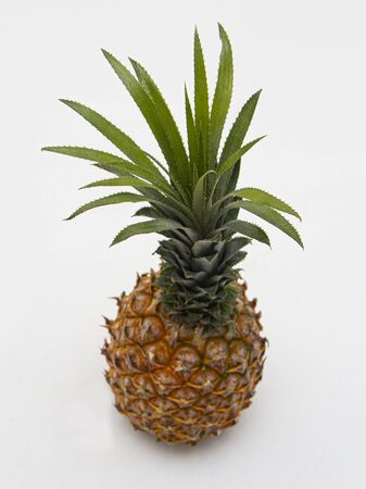 ripe pineapple on a white background white brick walls with shadow top view Stok Fotoğraf