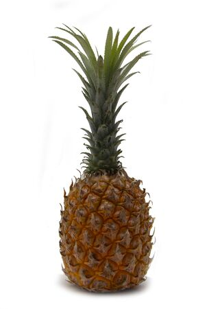 ripe pineapple on a white background wall with shadow