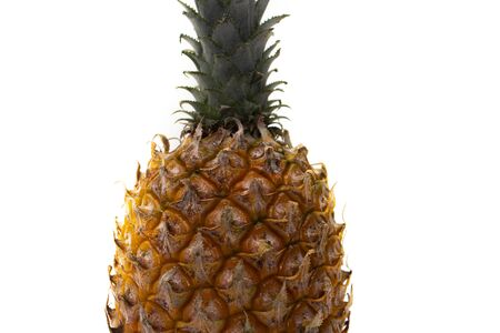 fragment of a ripe pineapple on a white background texture