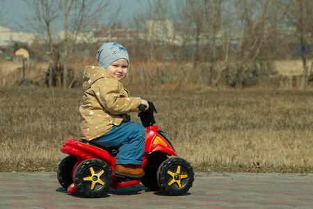 little boy on an electric Quad bike in the Park
