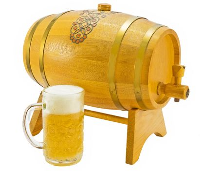 Wooden natural yellow a flank with the crane for beer on a support with a mug of beer on a white background photo