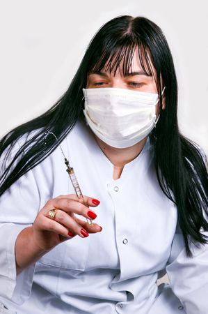 Medicine doctor with medical syringe in hands photo
