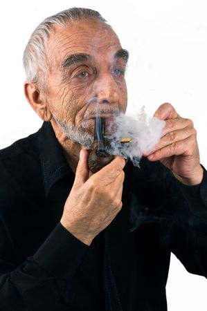 The elderly man getting a light a pipe photo