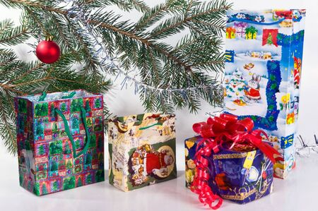 Christmas decorated fur-tree and packages with gift Stock Photo - 6046690