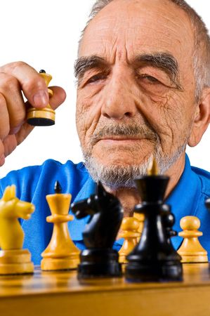 The elderly man playing chess photo