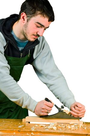 Man the carpenter working jointer on the white Stock Photo - 6628557