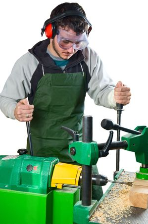 Man working on the drilling stationary machine tool photo