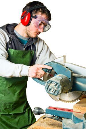 The man working as a circular saw photo
