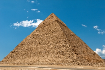 giza: Pyramid of Cheops against the cloudy sky