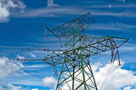 insulators: Electric support with wires and insulators against the cloudy sky Stock Photo