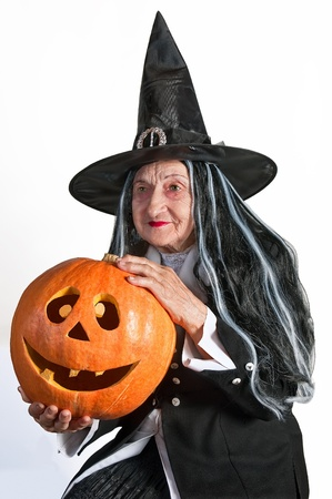 hag: Old hag in a hat with a pumpkin isolated on white