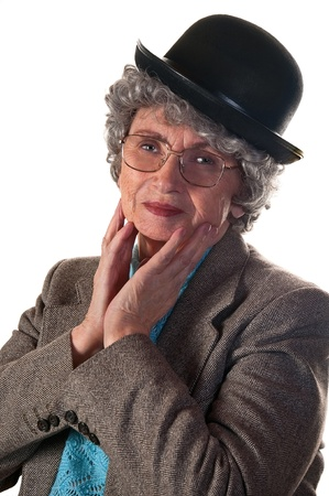 Cheerful elderly woman in a suit and bowler hat isolated on a white Stock Photo - 22010710