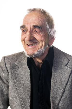 Smiling elderly man with a deeply lined face photo