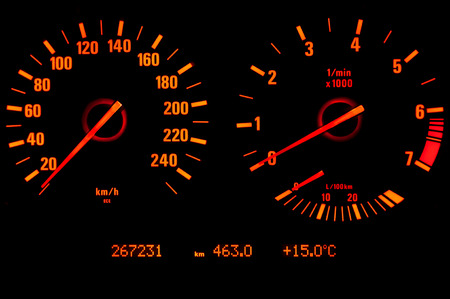 tachometer: Glowing speedometer and tachometer isolated on black