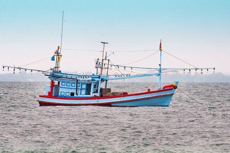 trawler: fishing trawler with garlands of lighting fittings on fishing