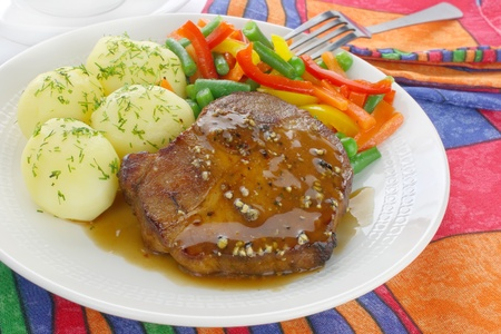 Pork meat with vegetables and sauce  photo