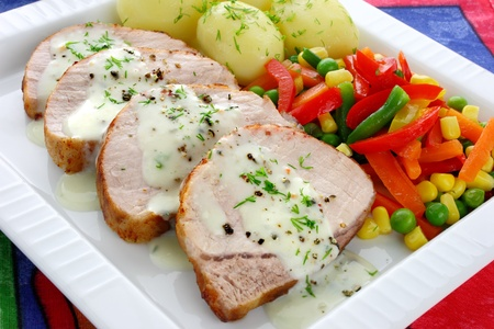 Pork meat with vegetables and sauce  Stock Photo