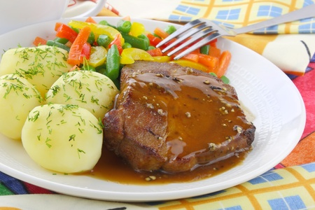 Pork meat with vegetables and sauce  Zdjęcie Seryjne