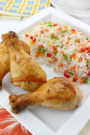 Fried chicken leg with rice and vegetables  photo
