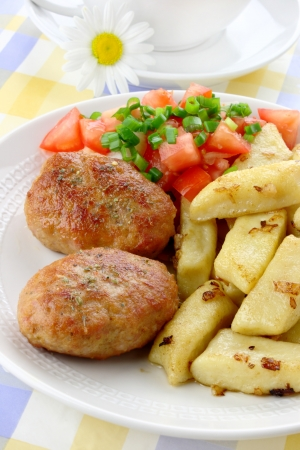 Meat cutlets with potato dumplings Stock Photo - 14353557