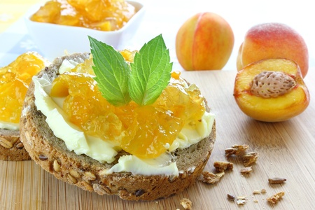 Sandwich with butter and peach jam