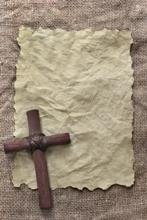 Wooden cross on old paper Stock Photo