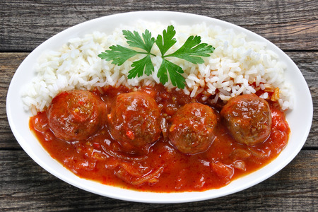 Pork meatballs in tomato sauce with rice Stock Photo