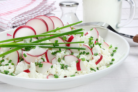 Cottage cheese with radish and chives Stock Photo
