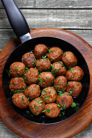 Fried pork meatballs in frying pan