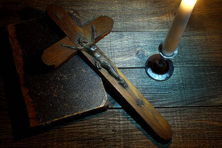 Cross and old book on wooden table  photo