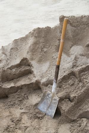 Shovel placed on a pile of sand  Stock Photo