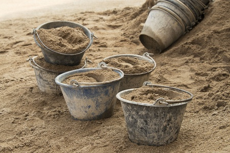 cement pile: Sand in a plastic bucket placed at the sand stack waiting for construction