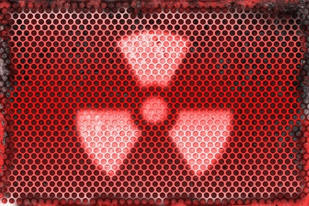 Burned metal abstract background of radioactive sign symbol  photo