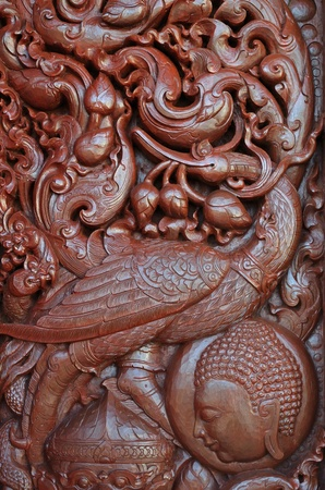 Bird, Wood Carving In Klang Vieng Temple, Chiang Rai Province, Northern Thailand photo