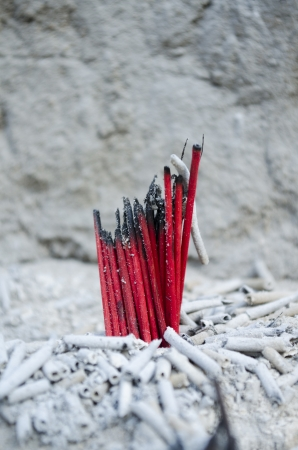 cinders: 1 bunch of red incense stick become extinct plug on a cinders  Stock Photo