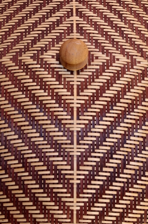 alternating: Top of bamboo confections  stripes alternating light brown and dark brown with wood ball handles  Handmade arts and crafts of Thailand   Stock Photo